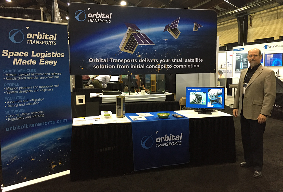 David Hurst at Orbital Transports booth at SmallSat Conference